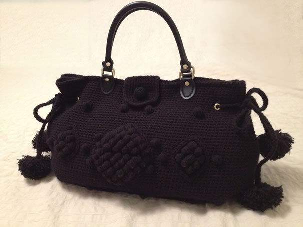 hand-knitted handbags from a local artist